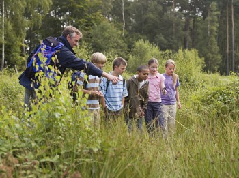 Teacher and pupils at nature reserve